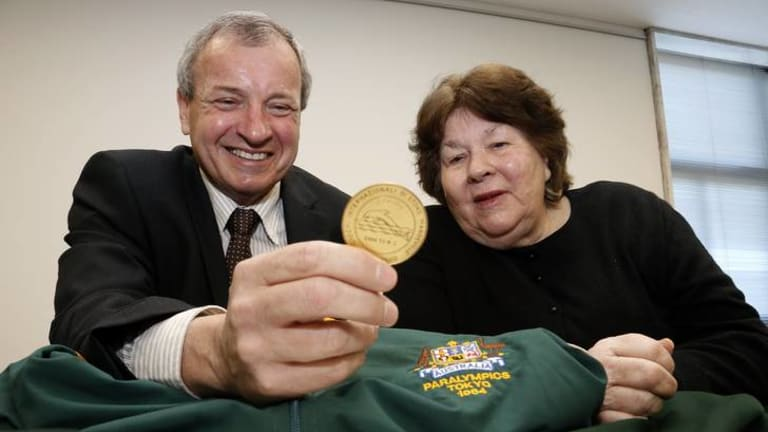 President of the Australian Paralympic Committee Greg Hartung has a look at the uniforms and medals donated to the Australian Paralympic Committee by Australia's first female Paralympian Daphne Hilton.