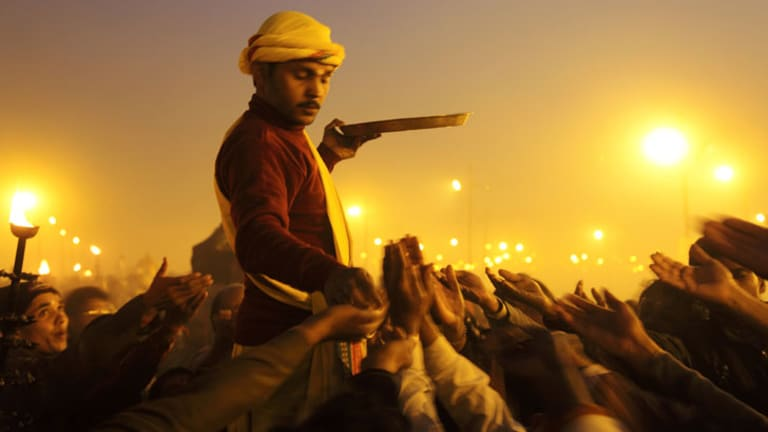 """The exhibition """"To Bathe"""" features photographs taken during the Kumbh Mela pilgrimage in India, in which millions of people bathe in the sacred Ganges River."""