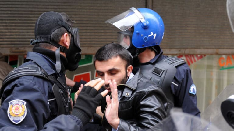 Turkish police arrest a Kurdish man during a demonstration in the main Kurdish city Diyarbakir.