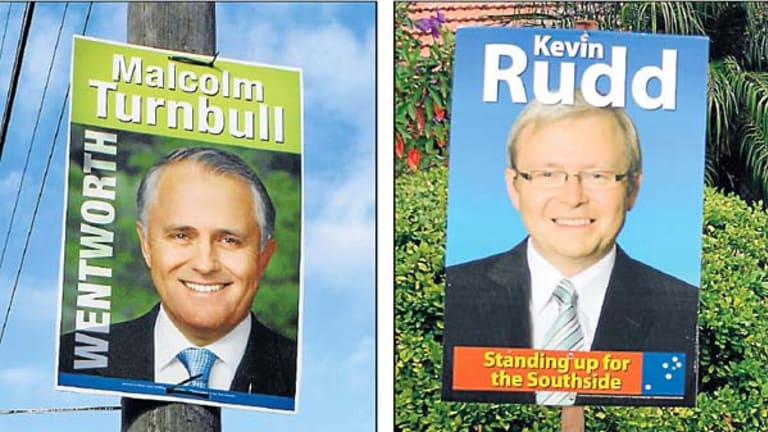 No frills brand . . . campaign posters for Malcolm Turnbull and Kevin Rudd missing their respective party logos.