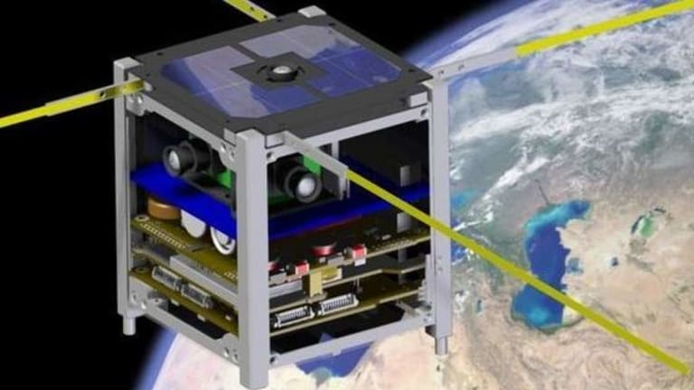 An artist's impression of one of the ArduSat satellites in orbit.