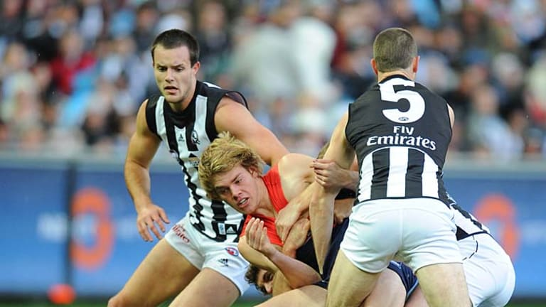 Three on one: The Magpies gang up on Jack Watts during his AFL debut on Queen's Birthday in 2009.