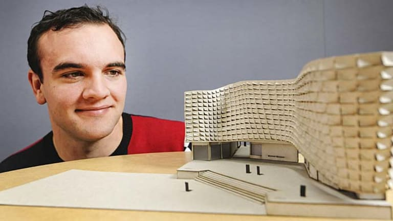 QUT architect student Alex Dickinson with his flood-proof building design.