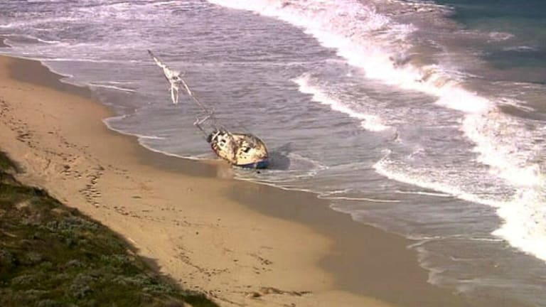 The stricken yacht, after it washed up on shore.