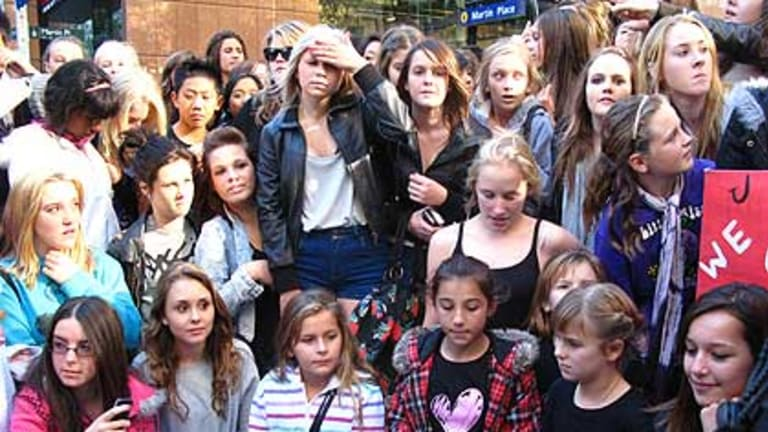 Disappointed fans wait outside Channel Seven's studio in Martin Place.