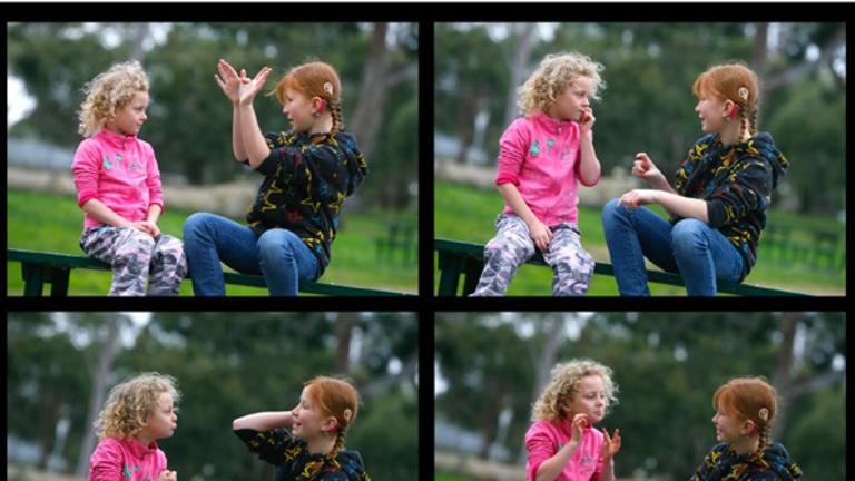 Five-year-old Kayla Trinder-Scacco and 10-year-old Sarah Keenan talk in Auslan.