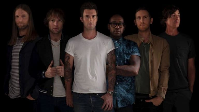 Adam Levine (centre) and bandmates presented a Maroon medley in Sydney.