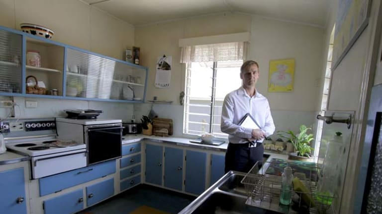 Risky business ... real-estate agent Rod Westerhuis at the property near Brisbane which will go to auction with no reserve asking price.