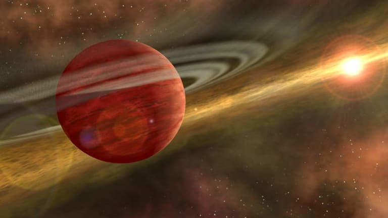 An artist's impression of a young planet in a distant orbit around its host star, similar to the HD106906 system that Doctor Who fans want to see renamed Gallifrey.