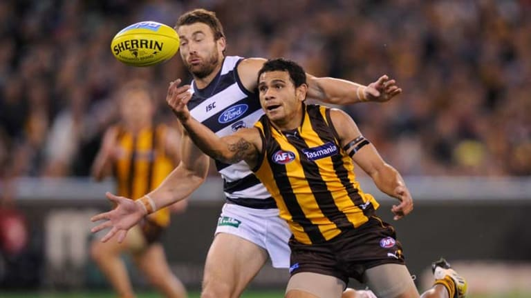 Cyril rioli battles Corey Enright.