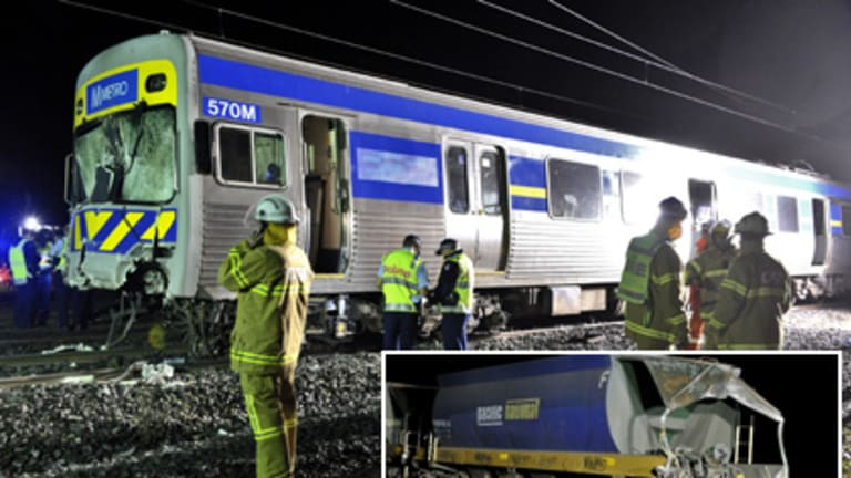 Emergency workers took 20 minutes to remove the injured passengers and driver from the Metro train after last night's collision with the freight train (inset).