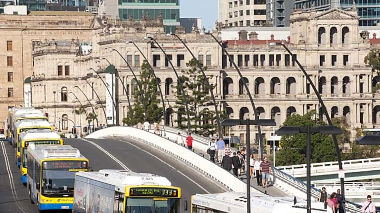 Buses line up across the Victoria Bridge during peak hour in Brisbane.
