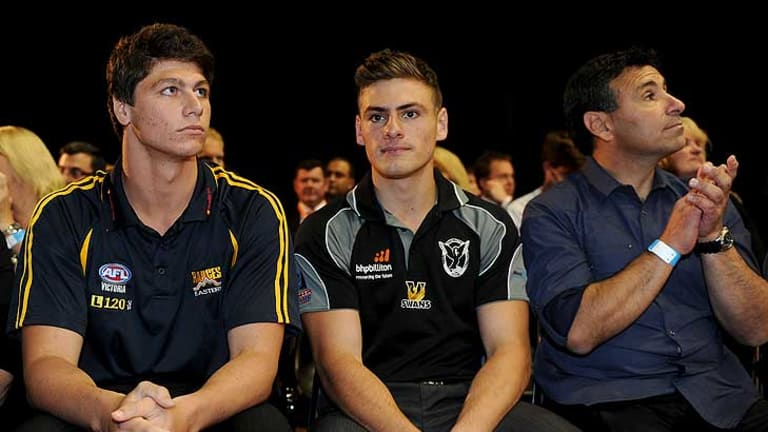 Swan Districts youngster Stephen Coniglio (centre) officially became a Greater Western Sydney Giant tonight.