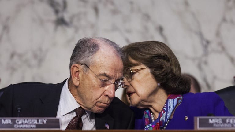 Senator Chuck Grassley, a Republican from Iowa and chairman of the Senate Judiciary Committee, left, speaks with ranking member Senator Dianne Feinstein, a Democrat from California.