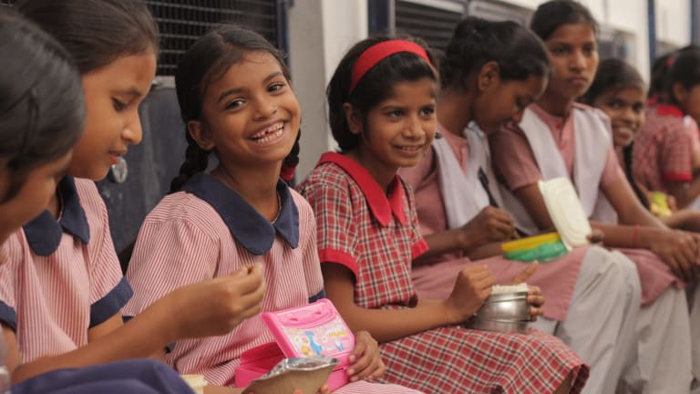 Students laugh at the Prerna Girls School, a place where girls are taught their rights as women in the world.