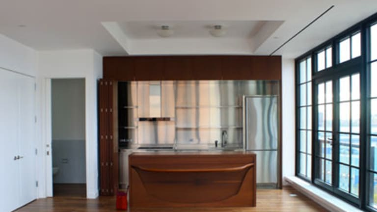 The kitchen. The apartment block is located in Chelsea.