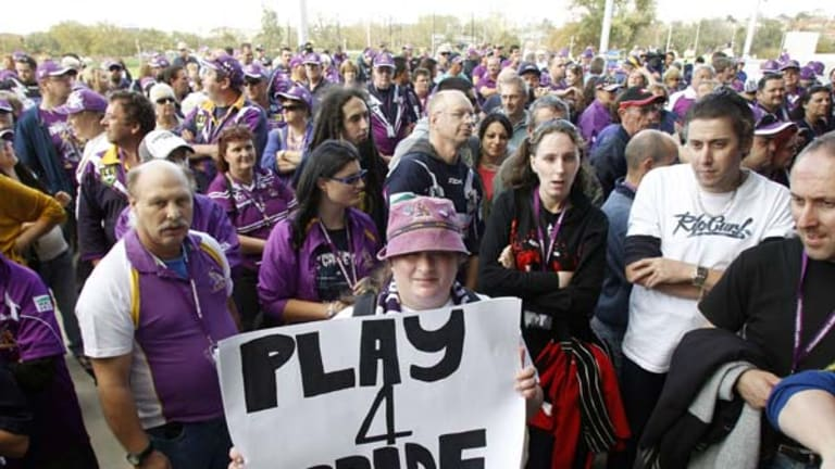Purple army ... fans turned up in their thousands yesterday for the Storm at the team's first training session since the club was punished for salary cap breaches.