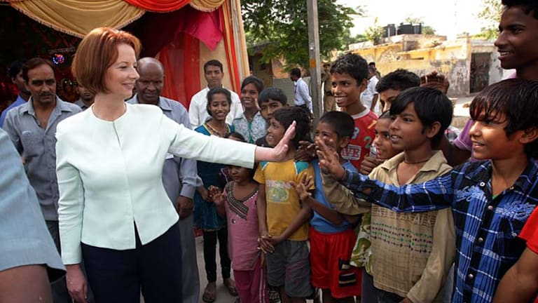 Slanting young … Julia Gillard meets Indian children.