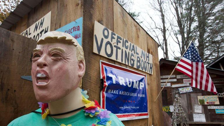 A mannequin for Republican presidential candidate Donald Trump is on display outside an outhouse used as an unofficial voting booth on a farm in New Hampshire.