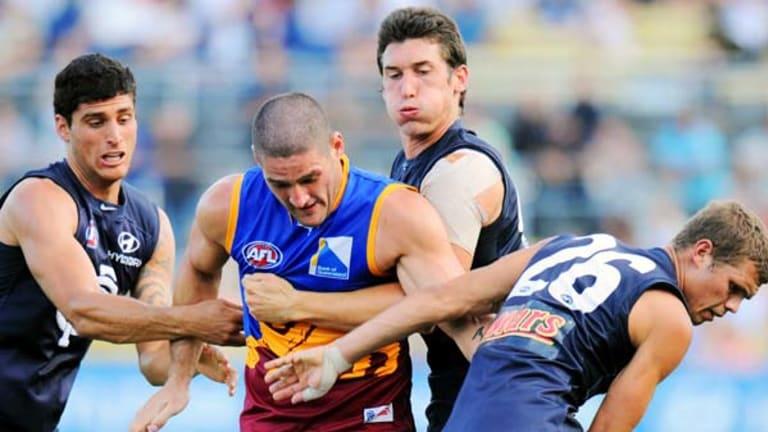 Brendan Fevola found himself hemmed in by former Carlton teammates when the two sides clash in the pre-season.