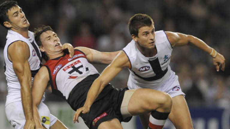 Alex Sillvagni (right) in NAB Cup game against St. Kilda.