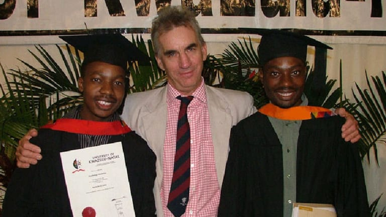 Roebuck with students he helped through university.