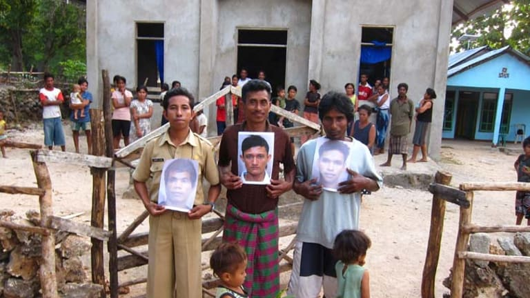 Lost boys of Indonesia ... relatives of three boys held for months in an Australian jail hold their photos.