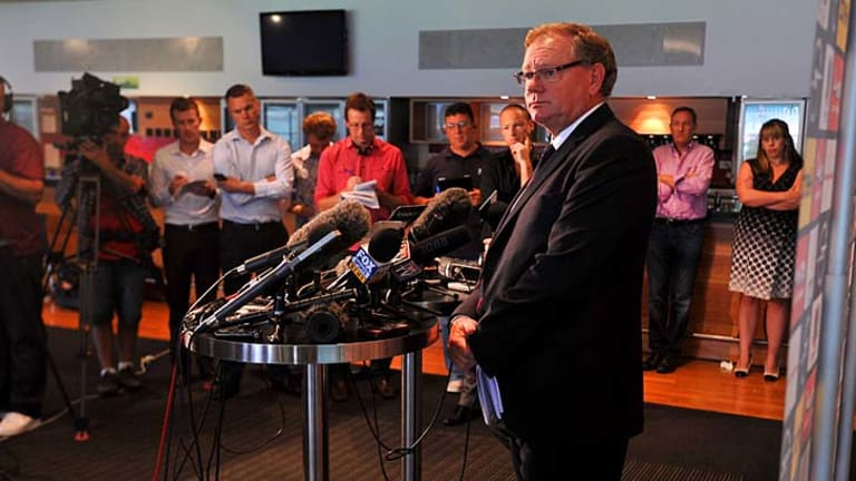 Dees fined: Don McLardy faces the media.