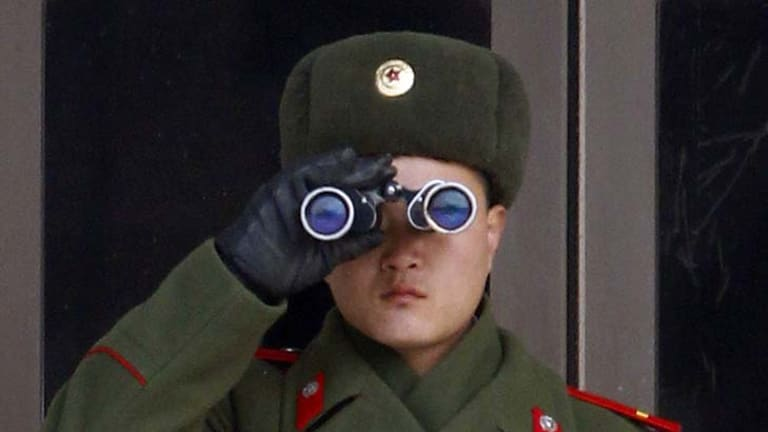 Keeping watch ... a North Korean soldier looks at the South Korean side in the demilitarized zone separating the two countries.