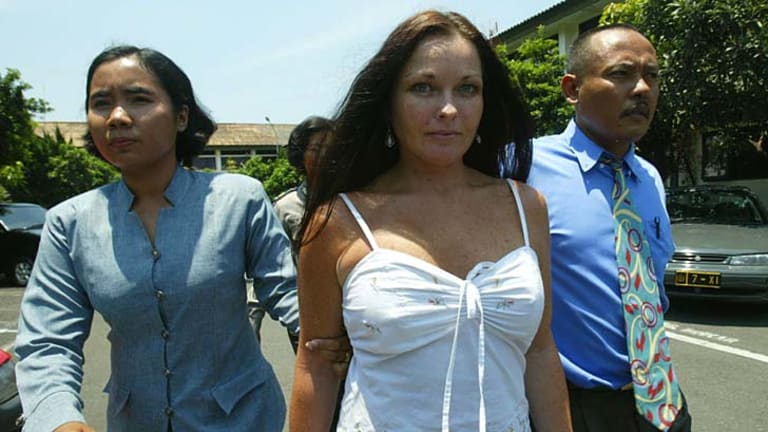 October 2004: Schapelle Corby lead by drug investigation officer to her prison cell after being caught with 4.2 kilograms of marijuana at Bali airport.