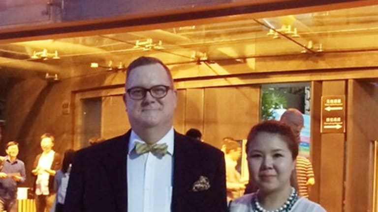 "Jeff Sikkema with wife Jiang Ling who he says was ''arrested her for processing visas""."