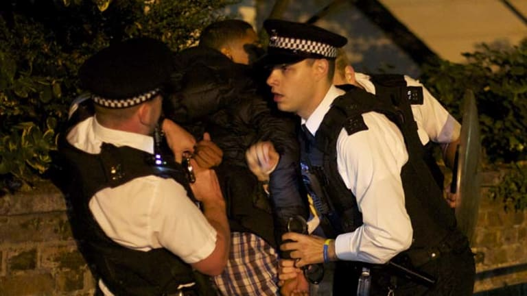 Dysfunction ... a youth is arrested by British police officers in Camden, north London.