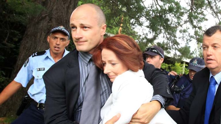 Prime Minister Julia Gillard is dragged to safety amid protests on Australia Day. The Opposition has called for inquiry into the leak that caused the security scare.