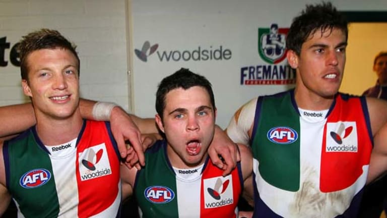 Winning is fun, but then you heave to heave-ho: Rhys Palmer, Hayden Ballantyne and Garrick Ibbotson do their Dockerly duties post-match.