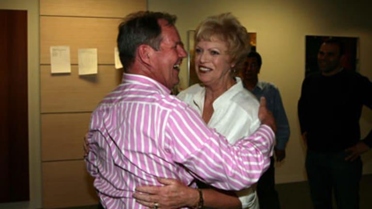 A jubilant Robert Doyle and deputy Susan Riley celebrate last night.