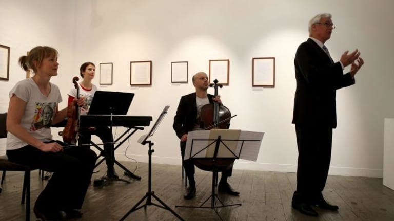 Julian Burnside with the Seraphim Trio, who performed the world premiere of Lyle Chan's composition.