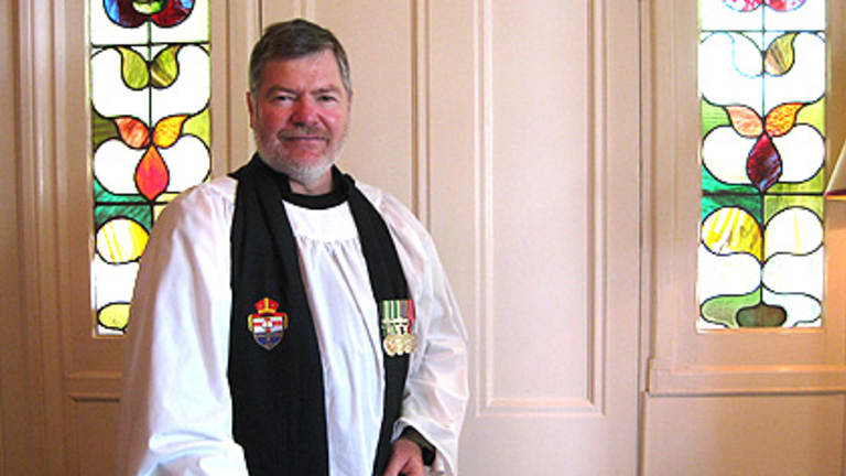 Enoggera-based army Chaplain Jim Cosgrove works magic penning poetry for our troops.
