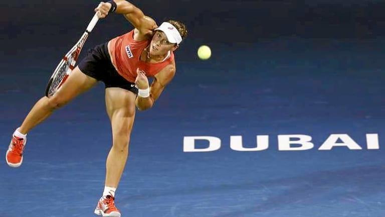 Samantha Stosur of Australia serves to Ekaterina Makarova WTA Dubai Tennis Championships.