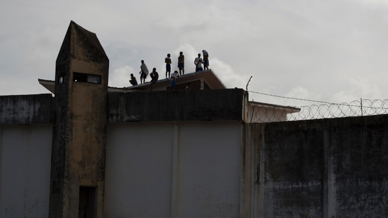 Inmates stand on the roof of Alcacuz prison amid tension between rival gangs in Nisia Floresta, near Natal, Brazil.