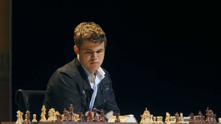 Master at work ... Competing at the 'Magnus Carlsen against the world' event in 2012.