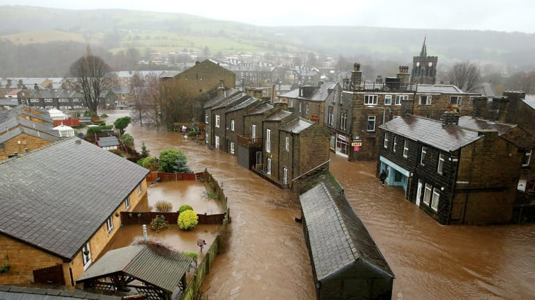 Floodwater rises as the River Calder bursts its banks, flooding the English town of Mytholmroyd.