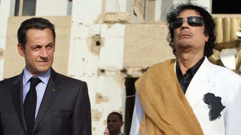 A file picture of the then president Nicolas Sarkozy with former Libyan leader Muammar Gaddafi. Mr Sarkozy is under investigation for receiving campaign funds from the Libyan dictator.