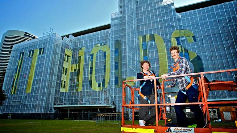''It could mean anything'': Artists Agatha Gothe-Snape and Mike Hewson with their artwork at the MCA.