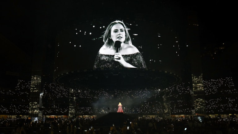 Adele, performing at Etihad Stadium, felt compelled to point out her big-screen image had some flattering filters on it.