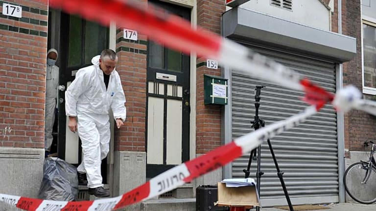 Deadly crime  ... forensic officers search for evidence.