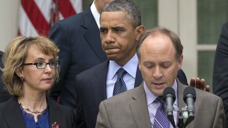President Barack Obama, flanked by shooting victim Gabby Giffords, left, and Mark Barden, the father of Newtown shooting victim Daniel, following the defeat of new gun control measures in the US Senate.