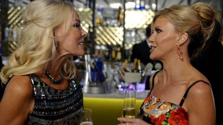 Snitching and bitching: Janet Roach and Gamble Breaux have champagne flutes poised for <i>The Real Housewives Of Melbourne</i>.