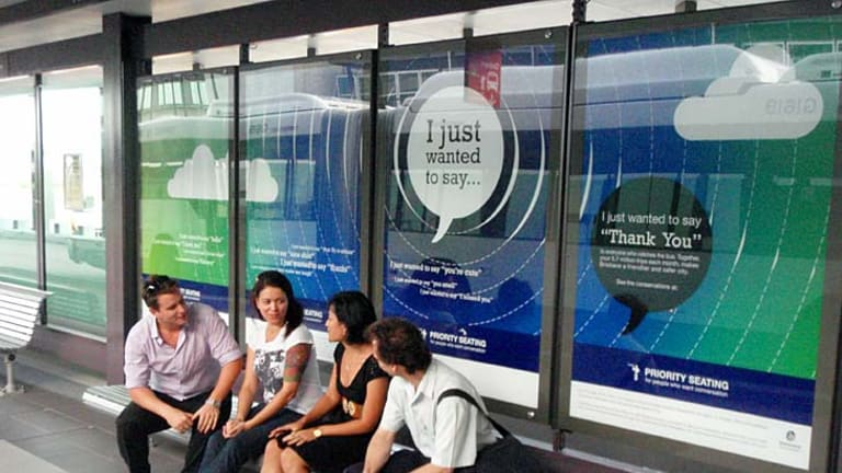 Signs at the Royal Brisbane and Women's Hospital busway urge people to chat to strangers.