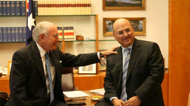 Former Prime Minister John Howard with former assistant treasurer Arthur Sinodinos.