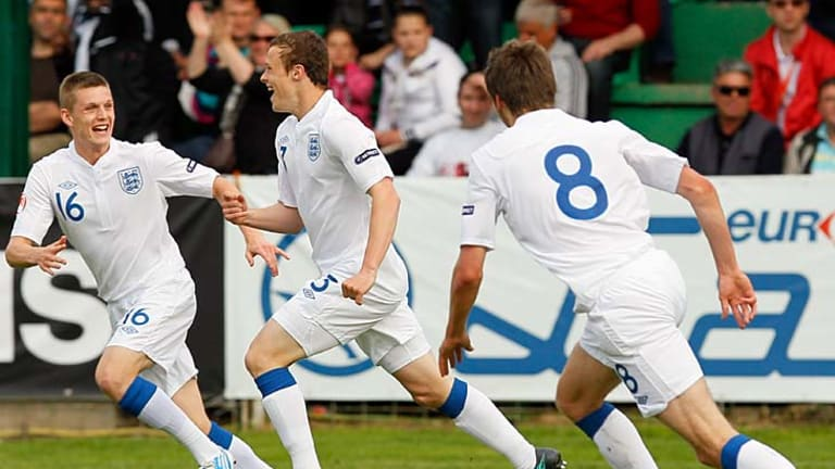 Fair dinkum talent ... Brad Smith, centre, celebrates scoring a goal for England at the under-17 European Championships in Serbia.